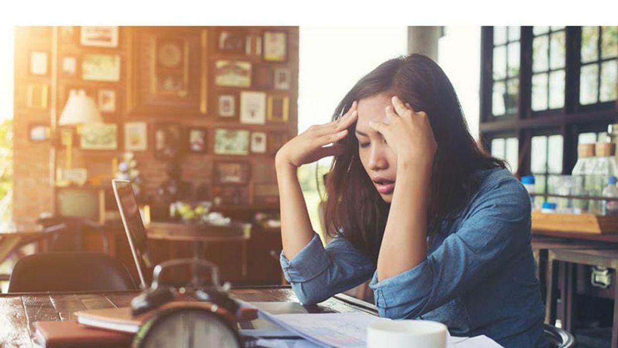 depressed woman behind desk