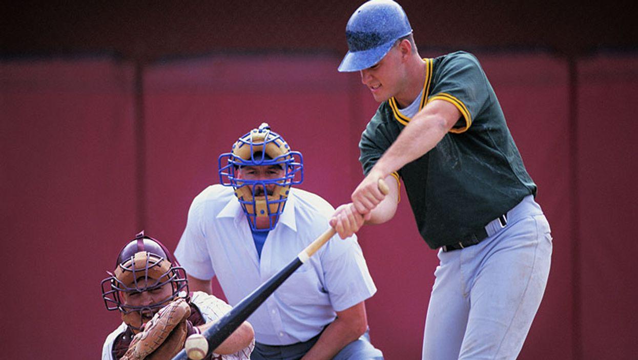 baseball batter swinging at a pitch