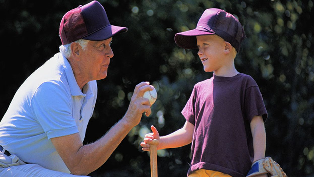 grandfather and grandson discussing baseball