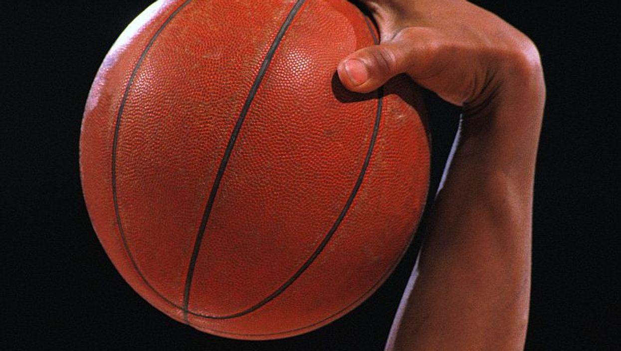 player palming basketball