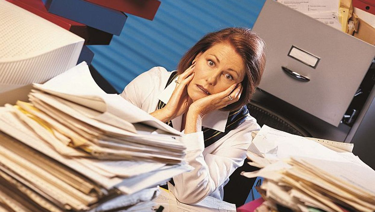 overwhelmed woman in office