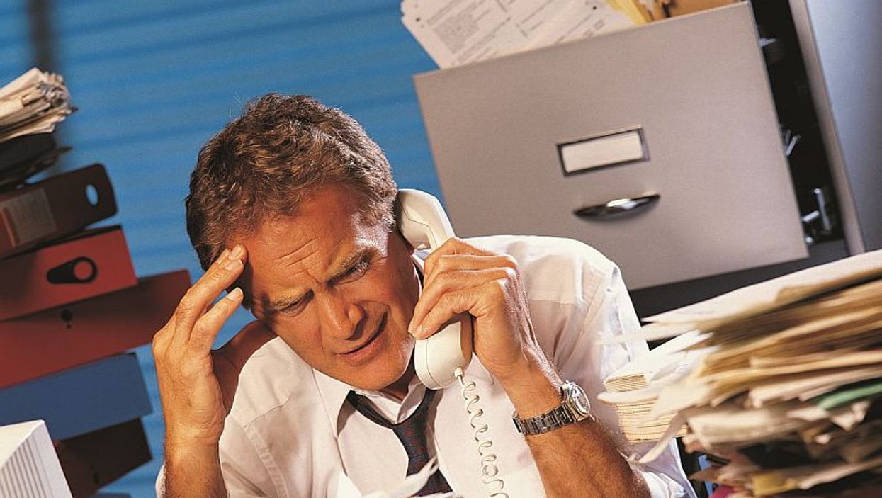 man on office phone