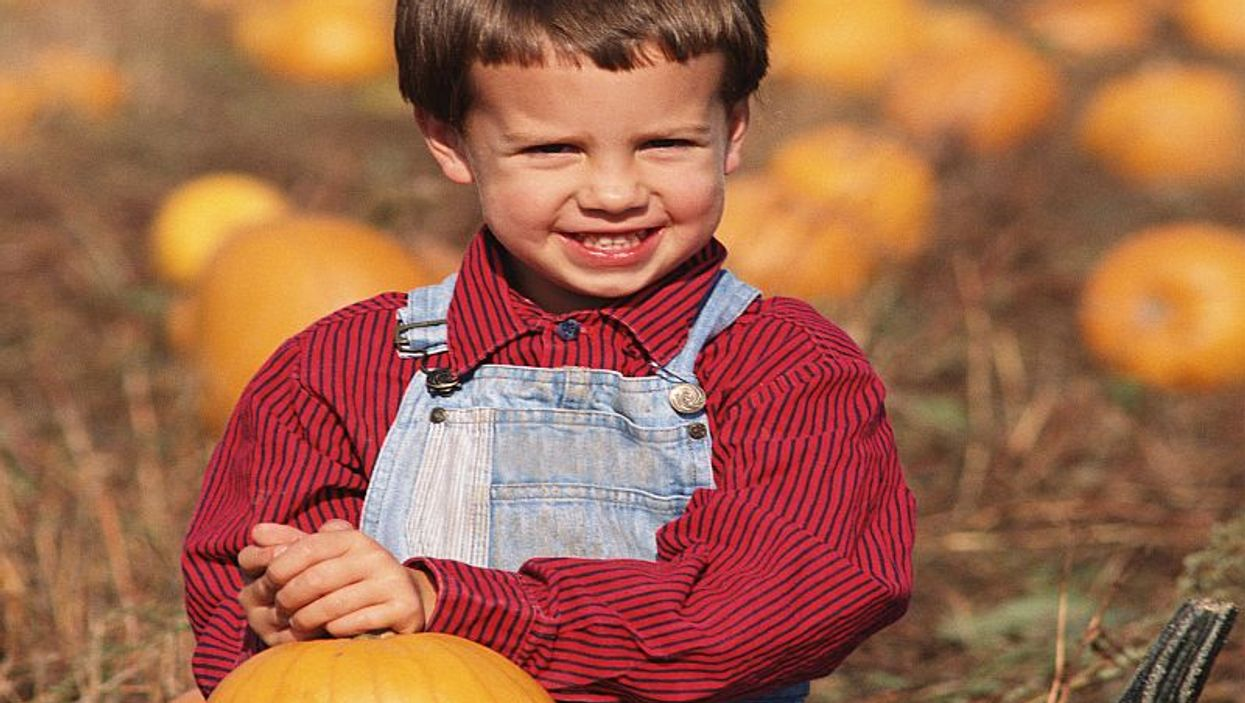 boy with a pumpkin smiling