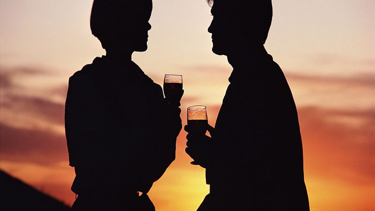 couple toast with glasses of wine