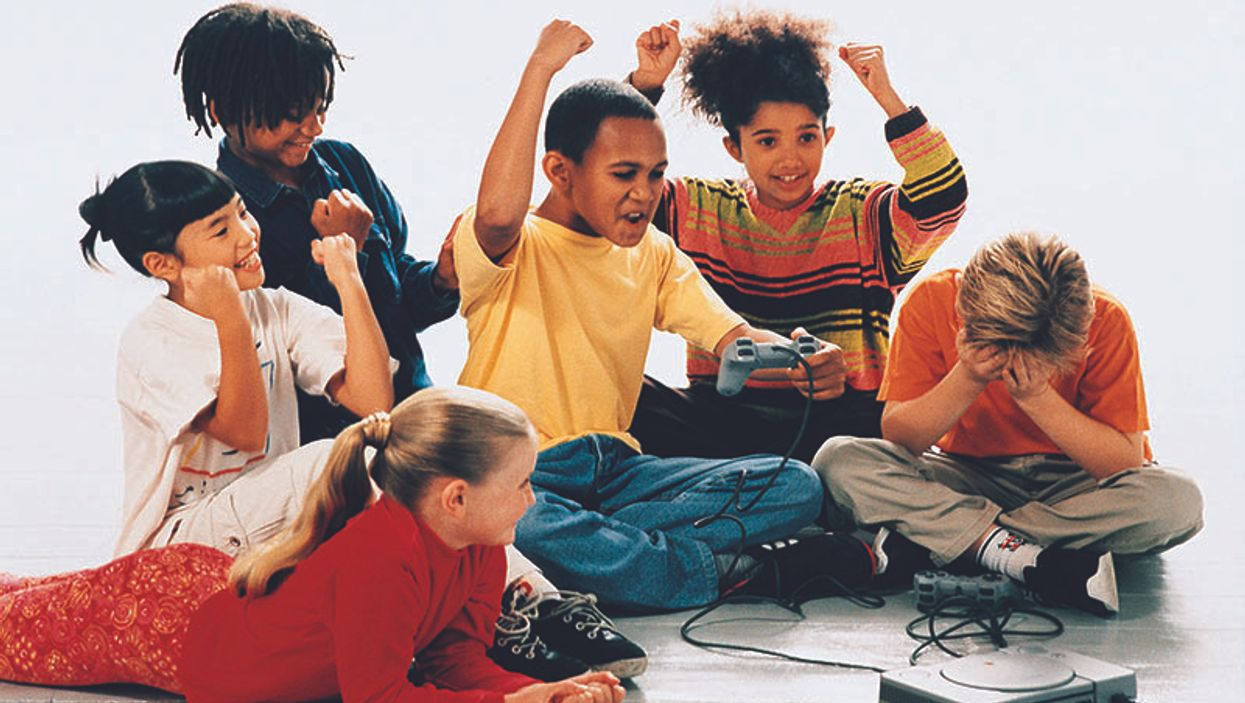 group of kids play computer game