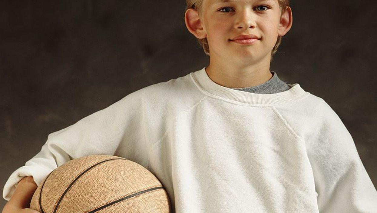 a boy with a basketball