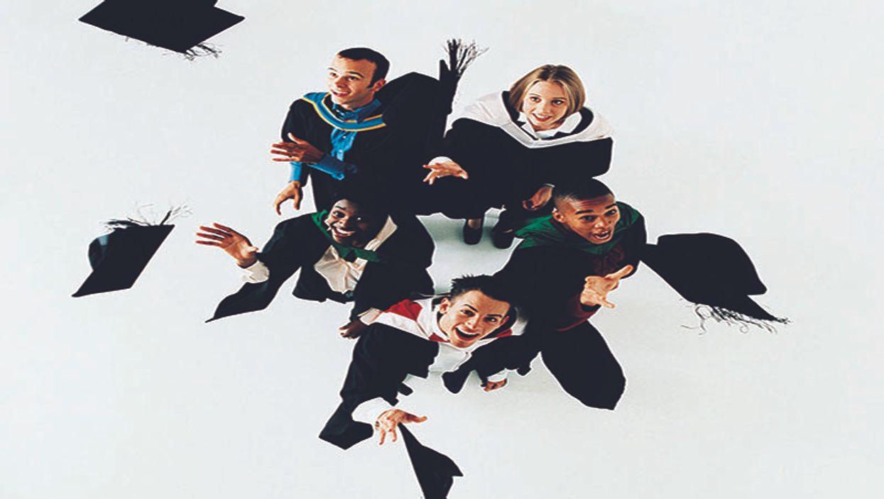 teens throwing graduation caps