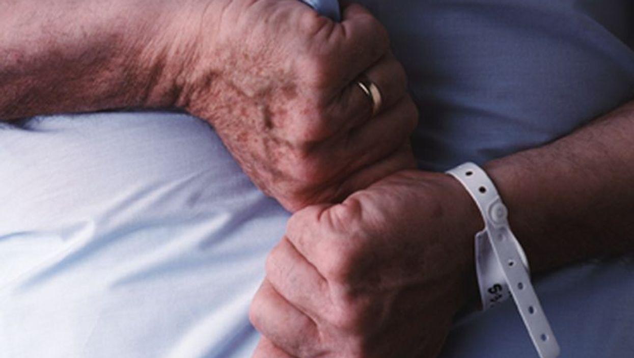 hands with a hospital wrist band