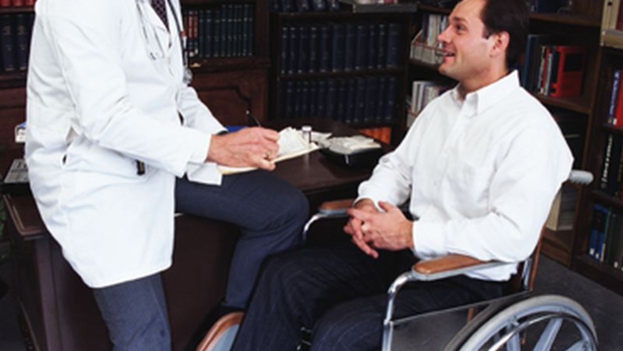 doctor talking to a patient on a wheelchair