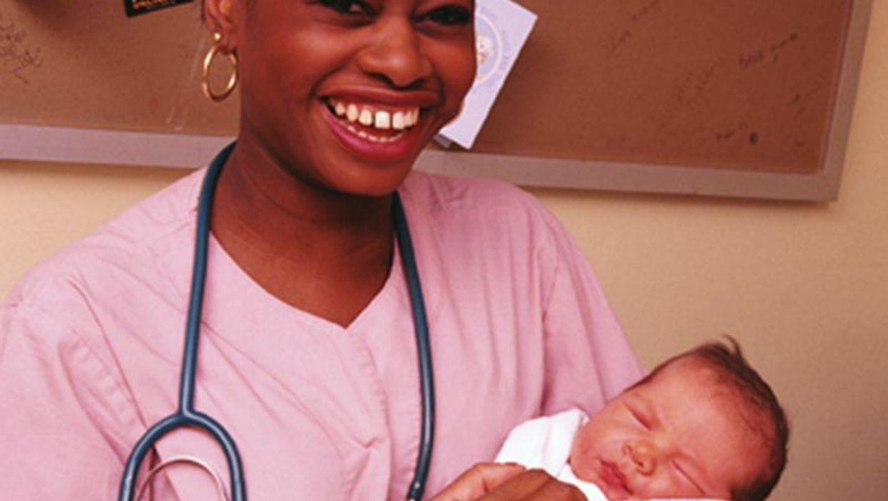 nurse with newborn