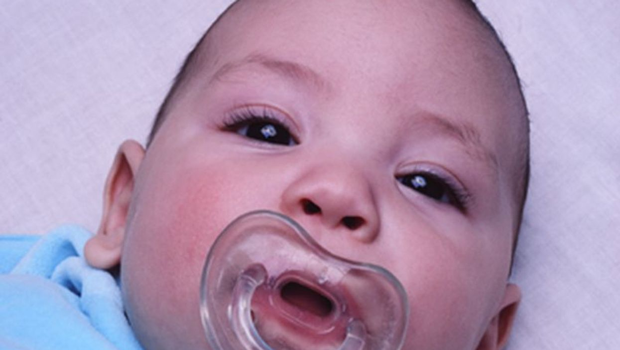 newborn with pacifier