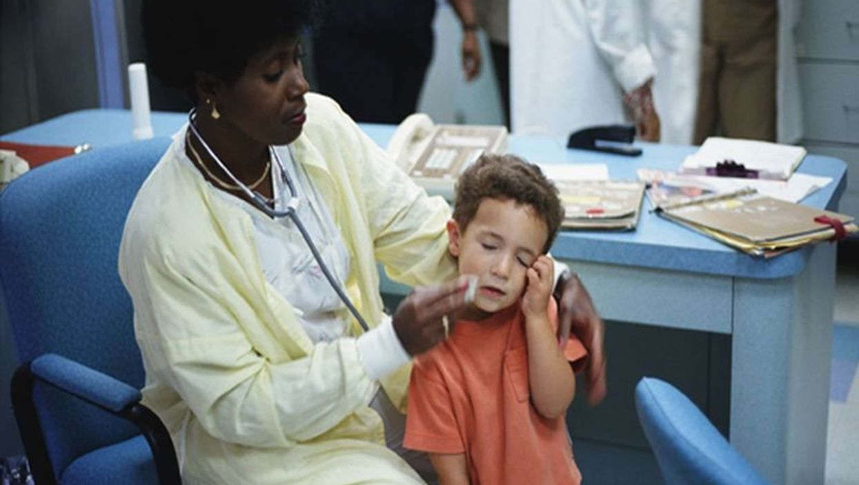 a boy crying because of injury