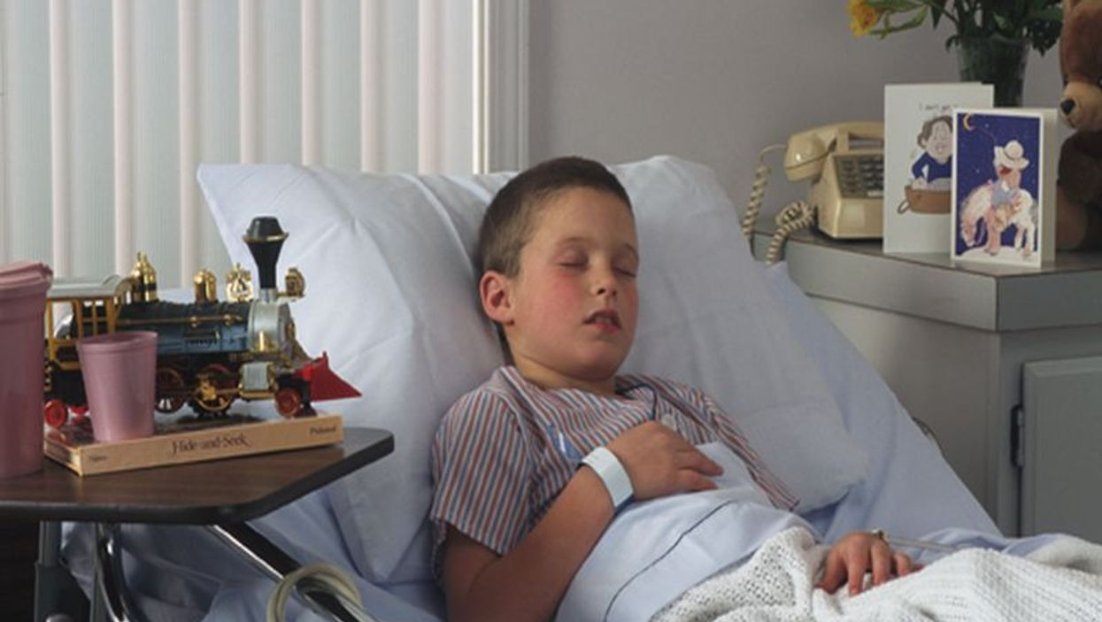 a boy on a hospital bed