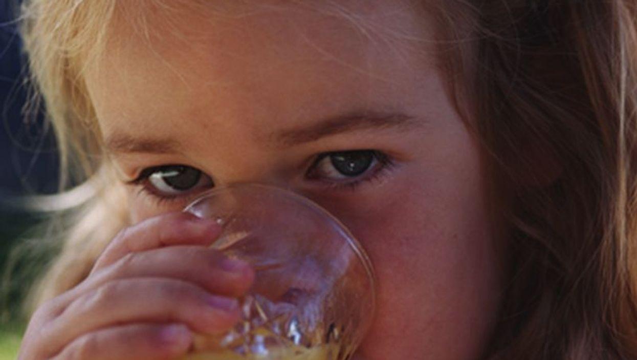 girl drinking an orange juice