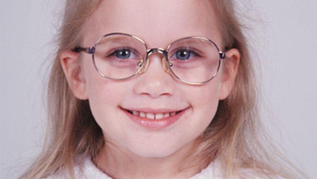 girl smiling wearing glasses