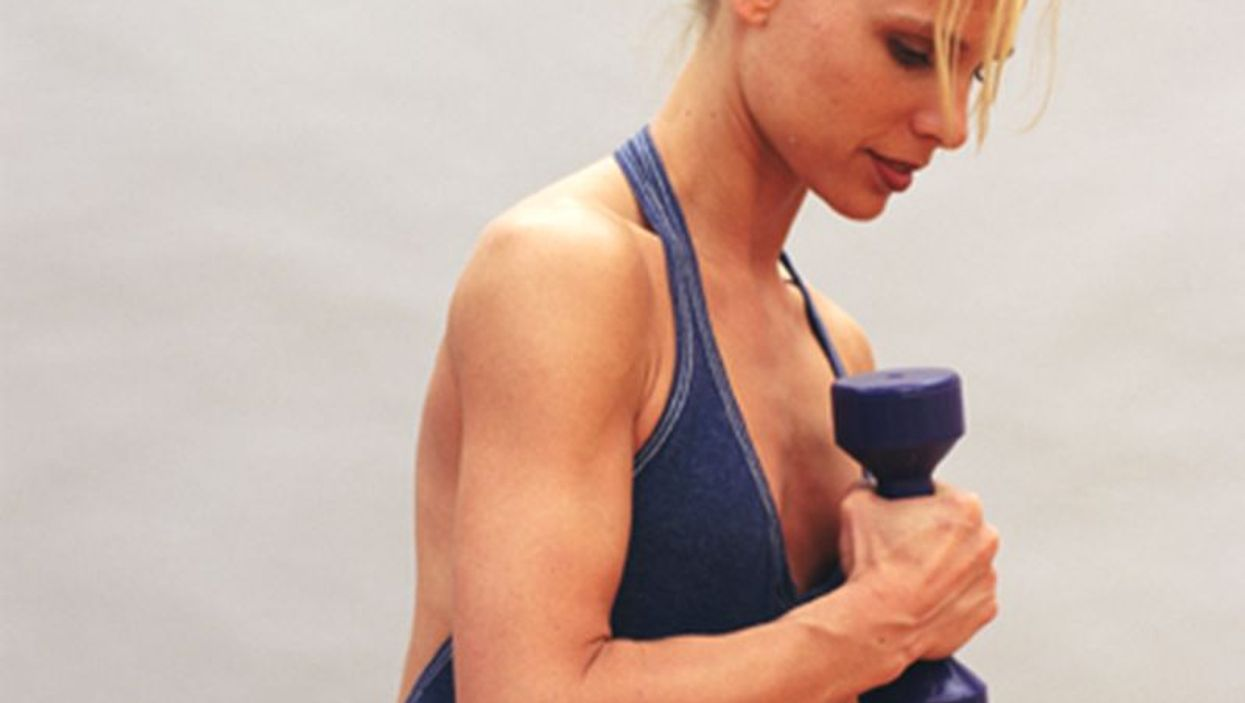 woman using dumbbell