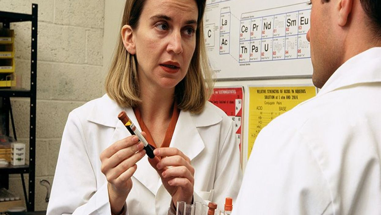 doctors showing specimens