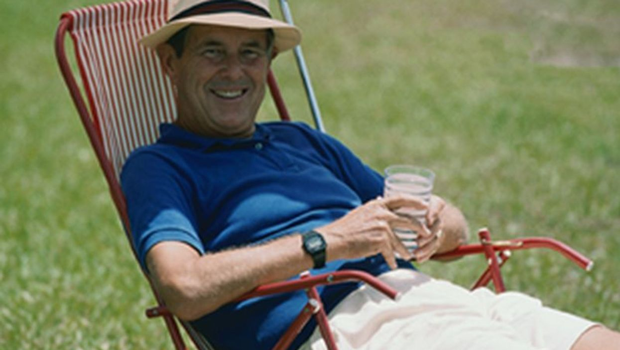 man relaxing on the lawn chair