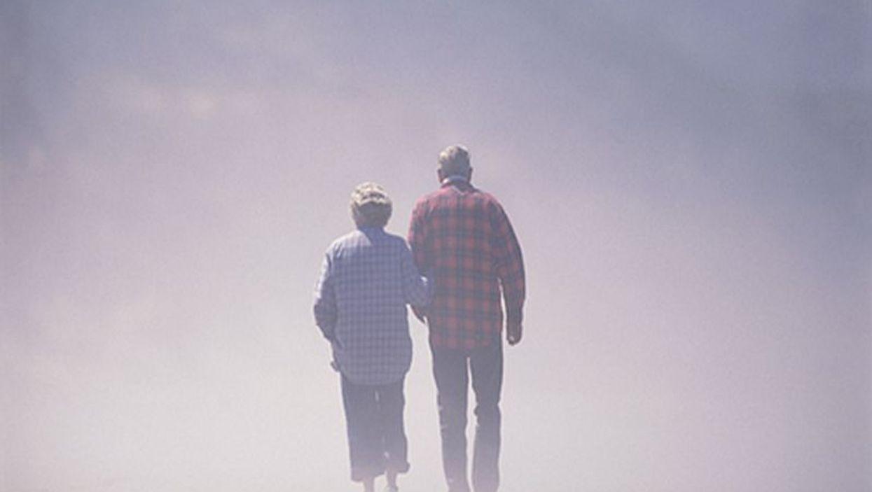 elderly couple surrounded by fog