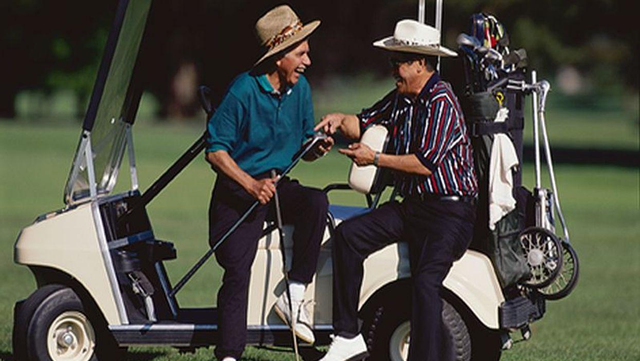 men on a golf cart