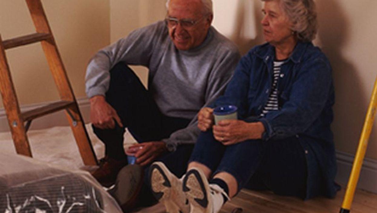 elderly couple painting