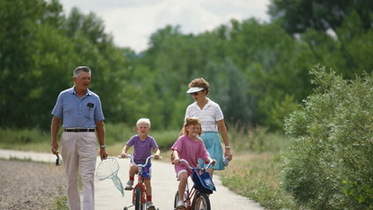 grandparents with grandchildren during bike ride