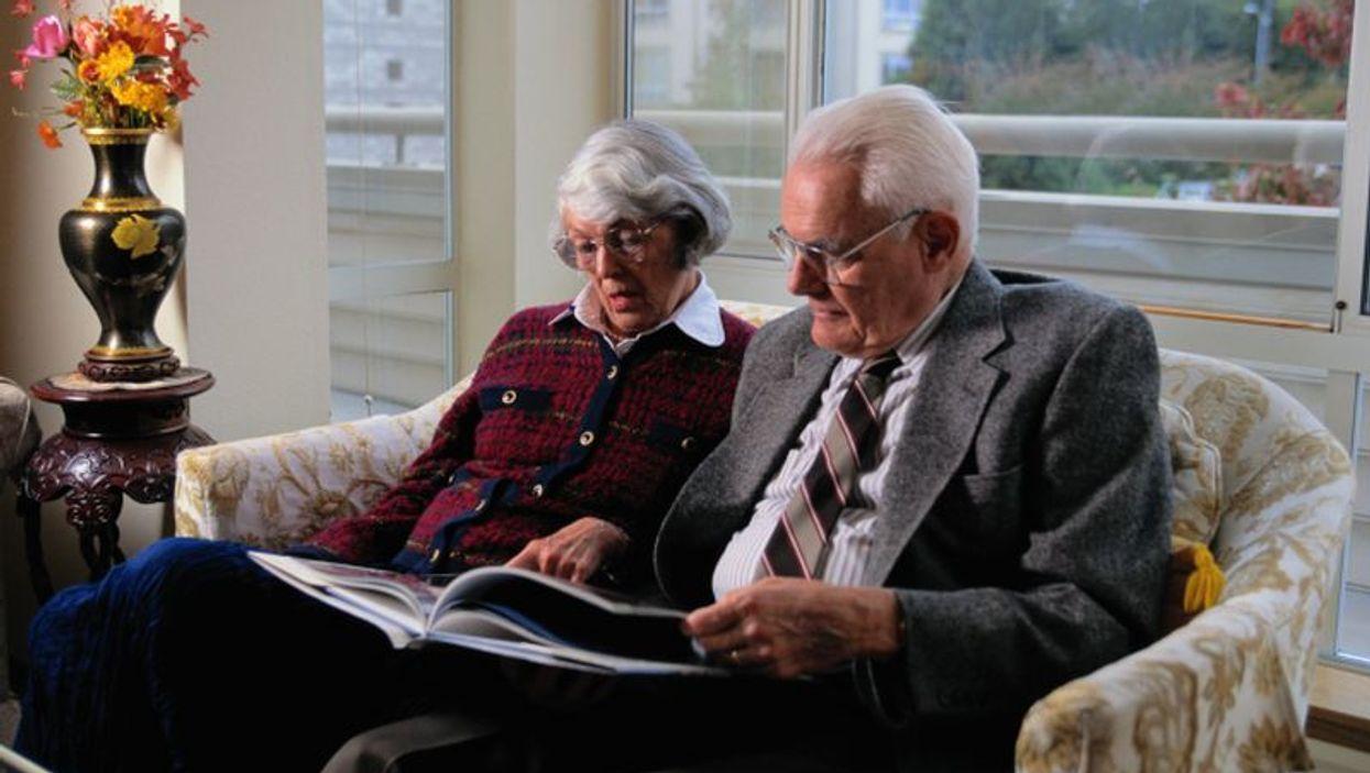 Seniors reading a book