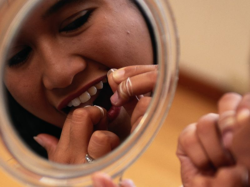 News Picture: Study Ties Gum Disease to High Blood Pressure