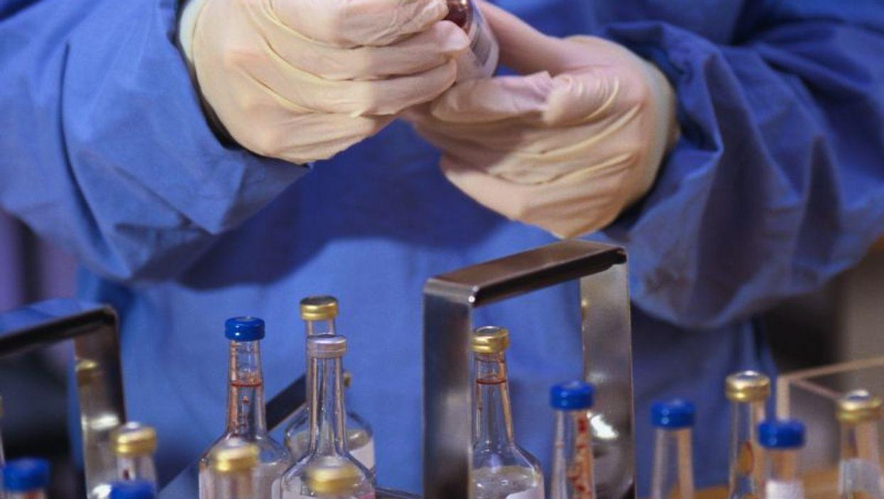 technician working with laboratory specimen