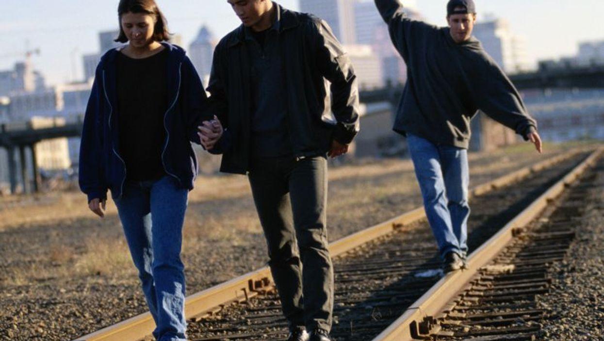 teens on a train tracks