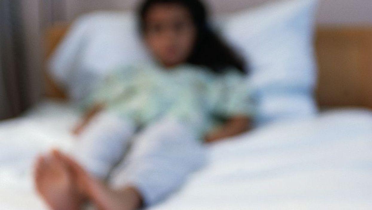 child lying on a bad
