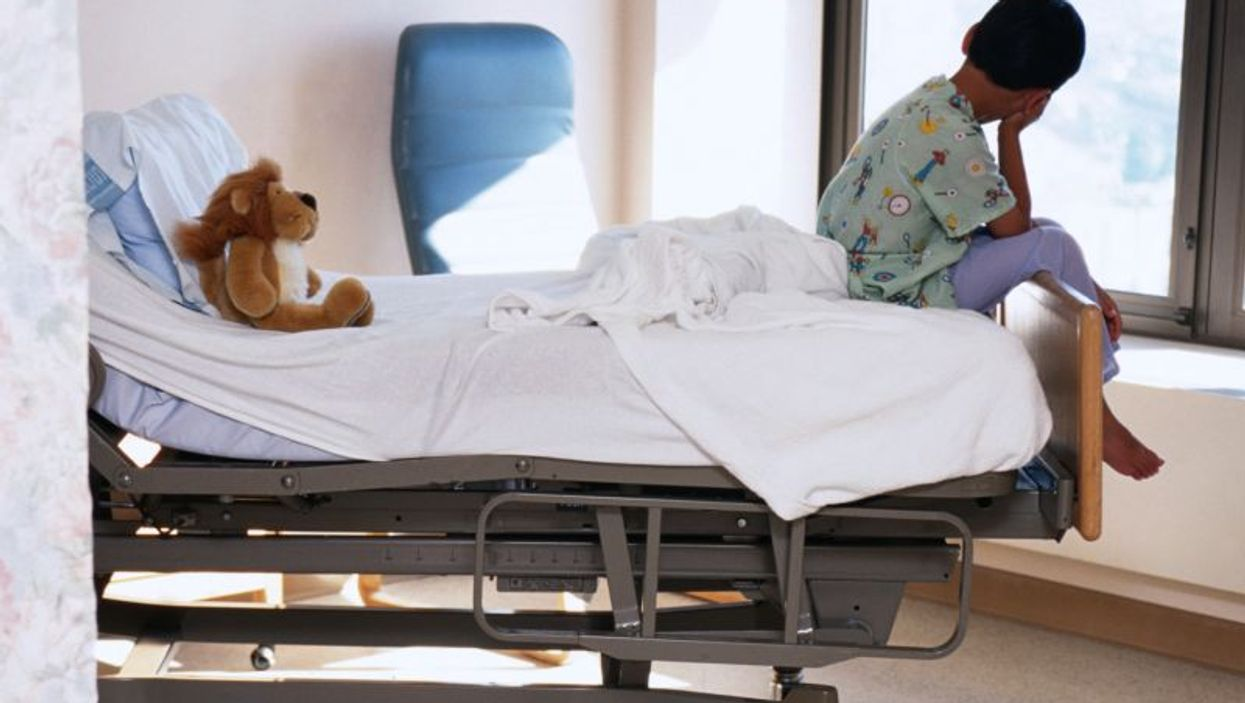 a child on a bed in a hospital