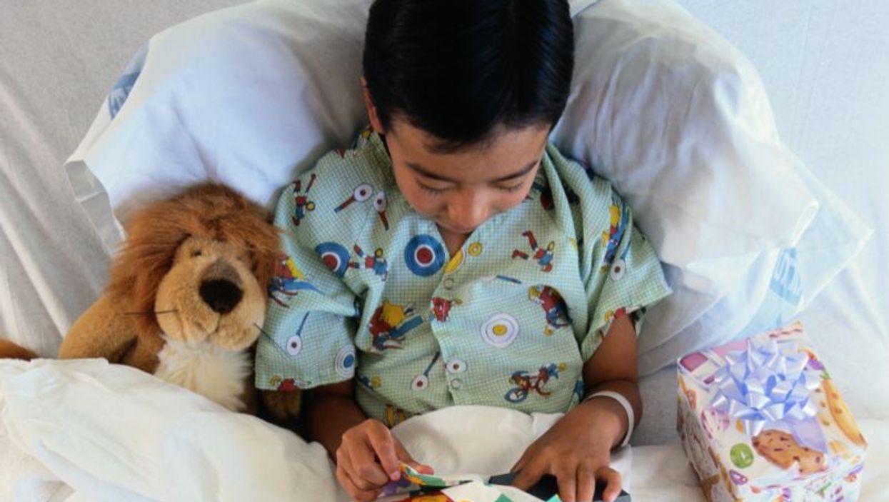 a boy on a hospital bed