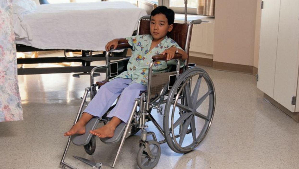 a child on a wheelchair
