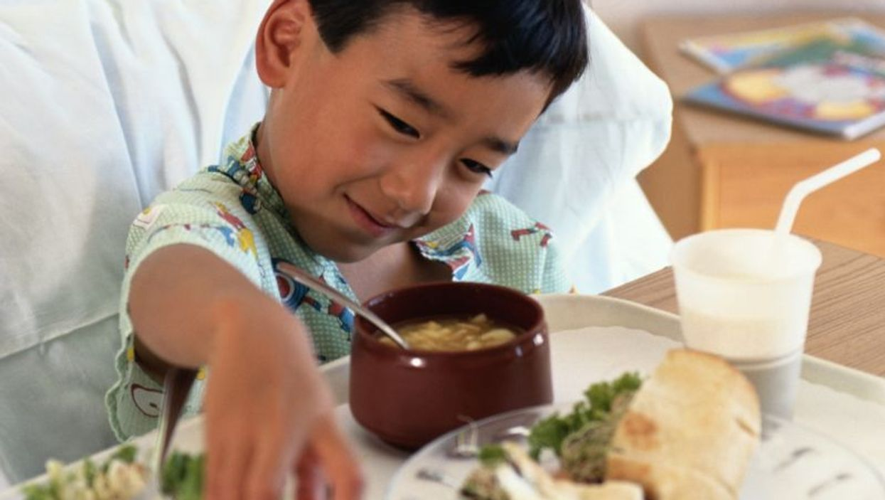 a child eating hospital food