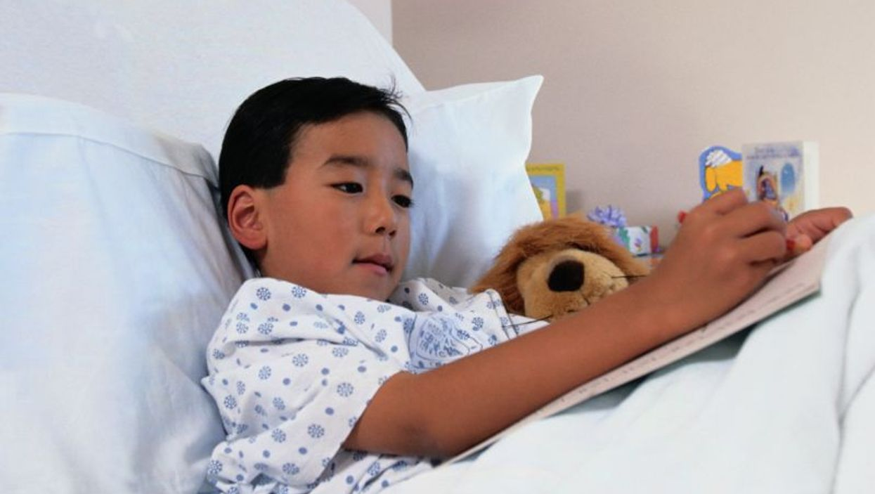 a child on a hospital bed