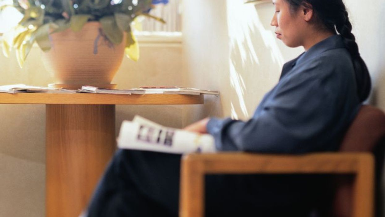 woman waiting in a medical office
