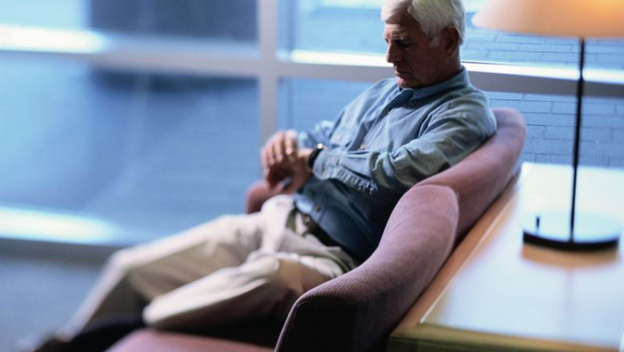 man waiting in a medical office