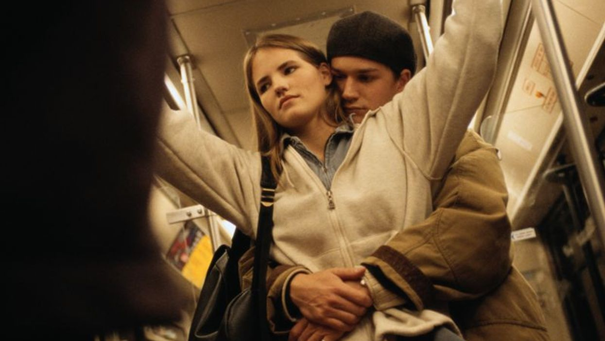 teen couple on the subway