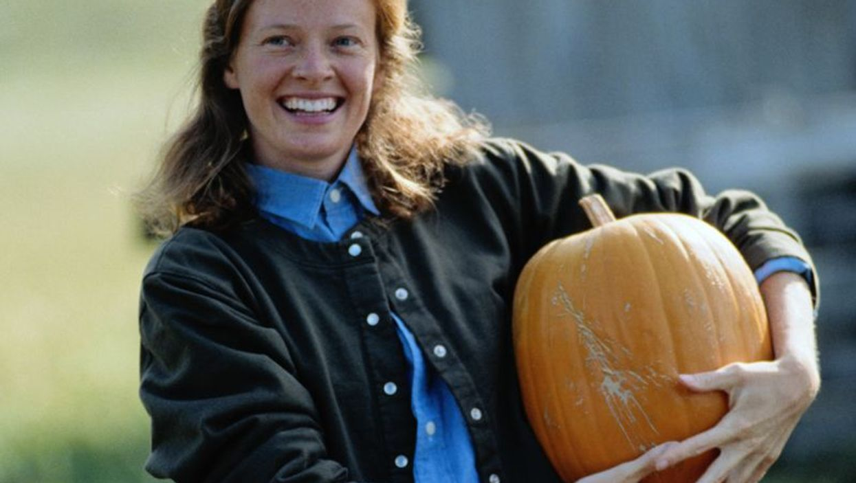 woman with a pumpkin