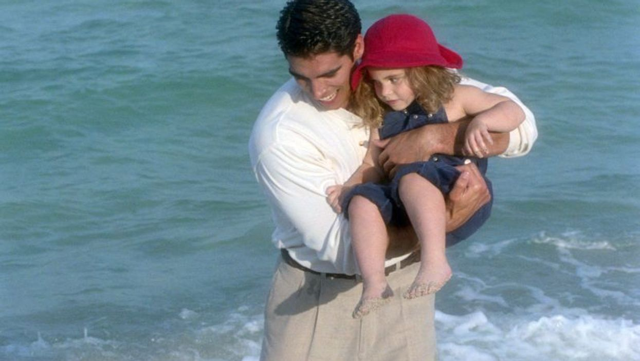 father and a girl at the beach