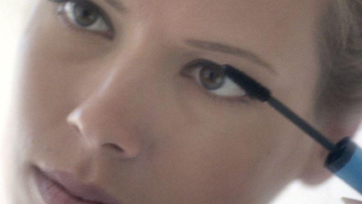 woman putting makeup on