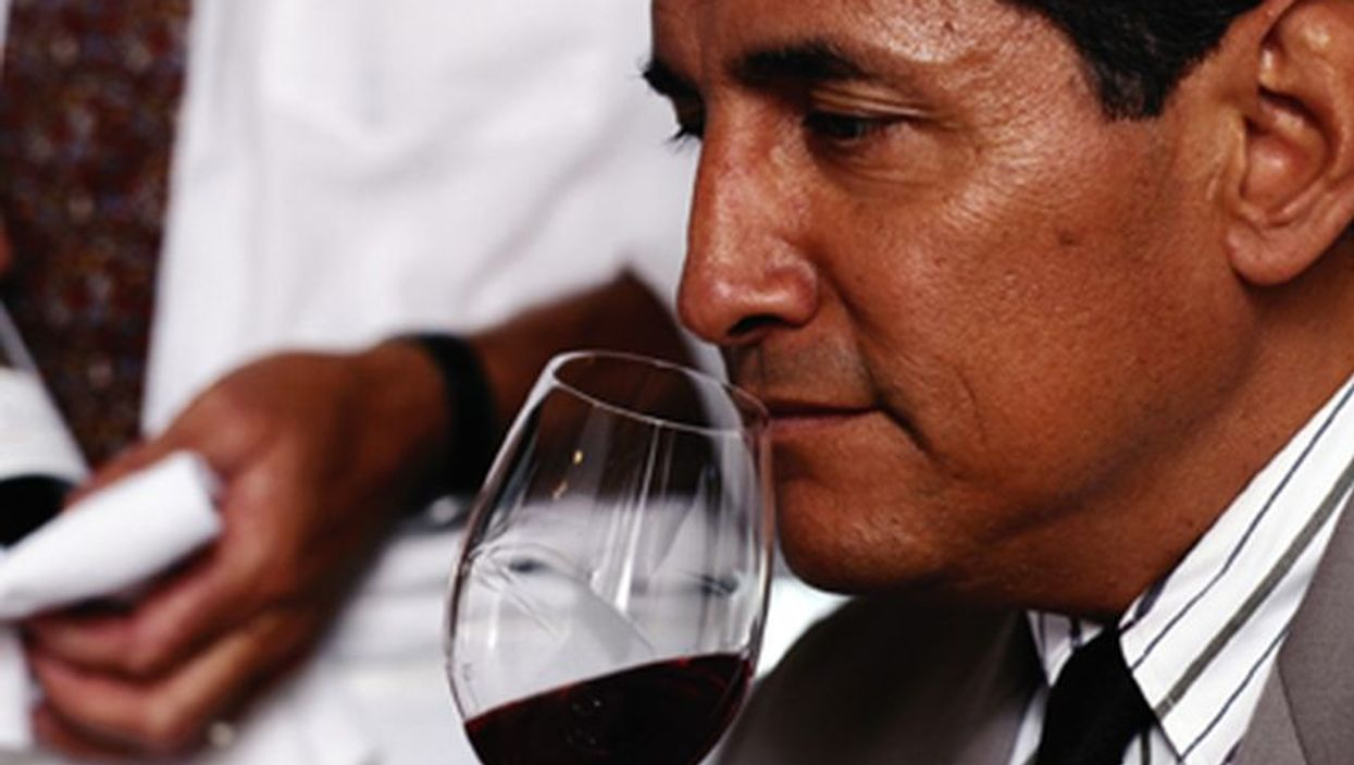 man tasting the wine
