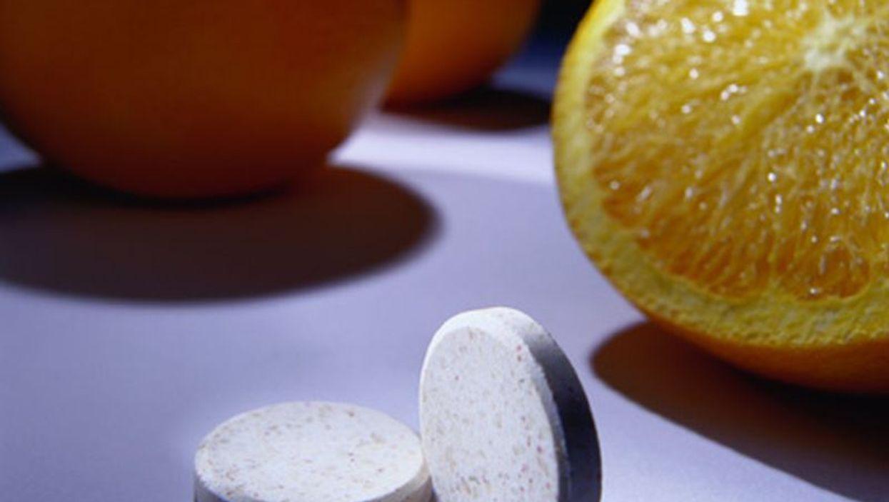 pills and an orange