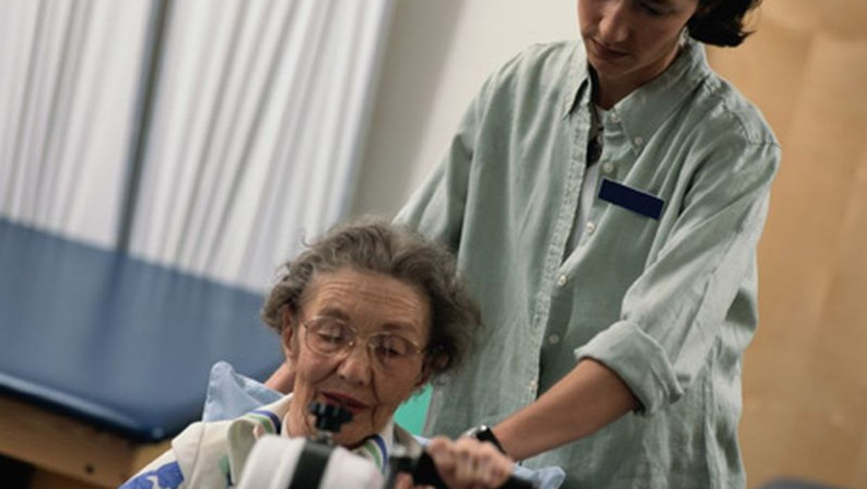 elderly woman in physical therapy