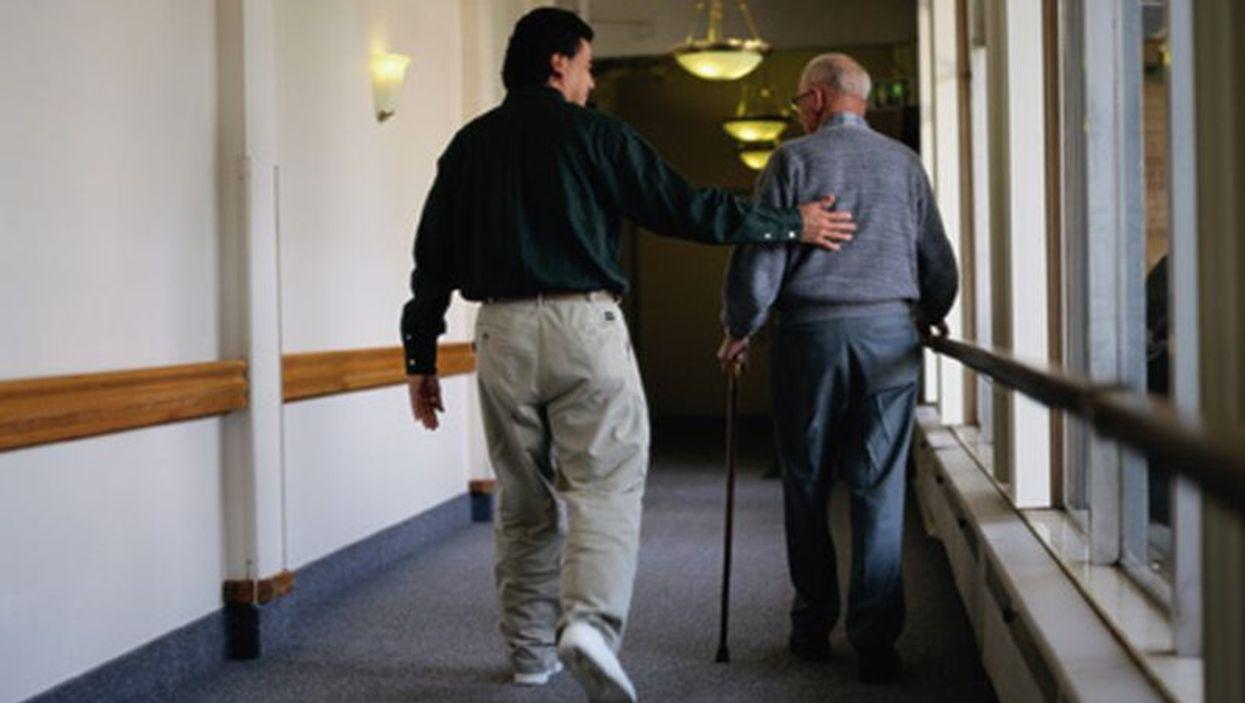 elderly man and caretaker