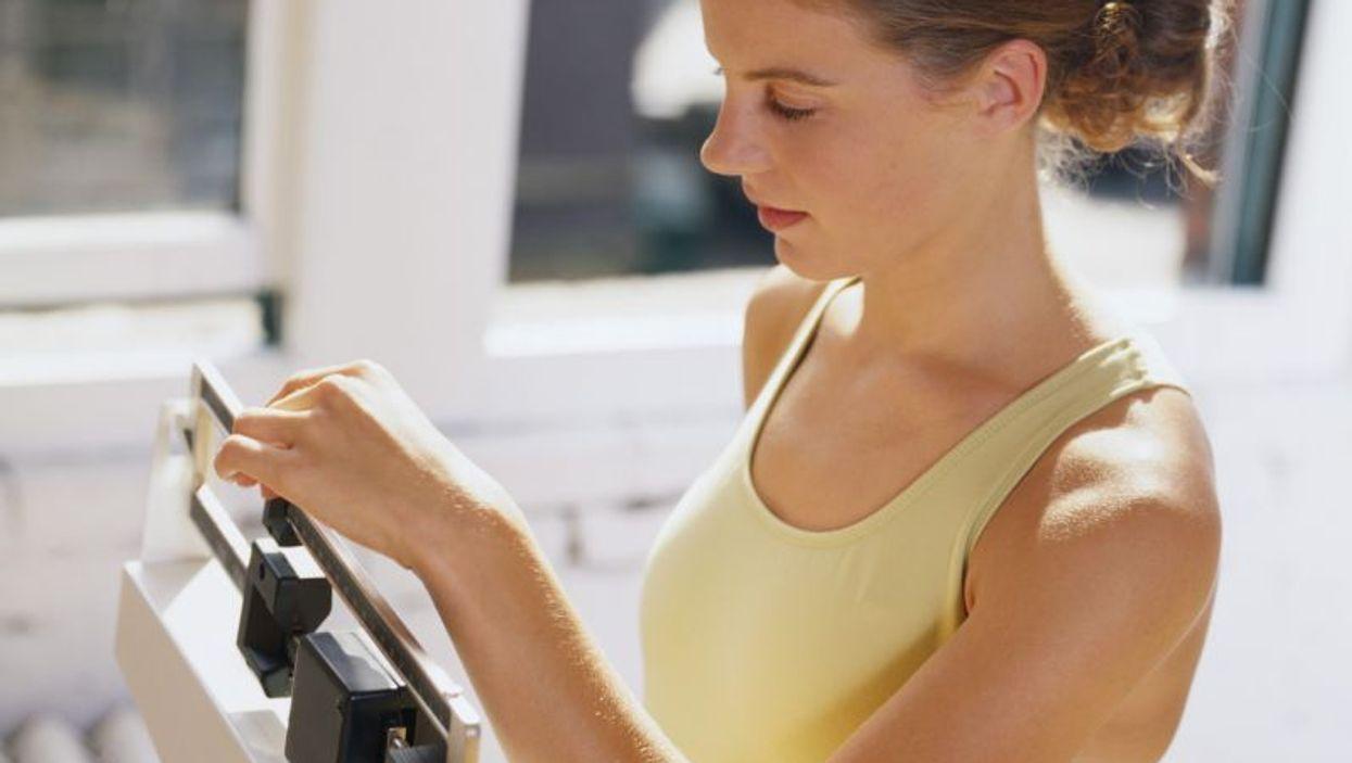woman weighing self