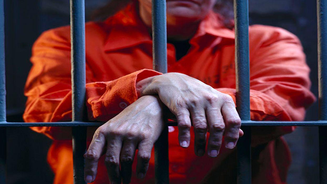 woman behind a prison bars