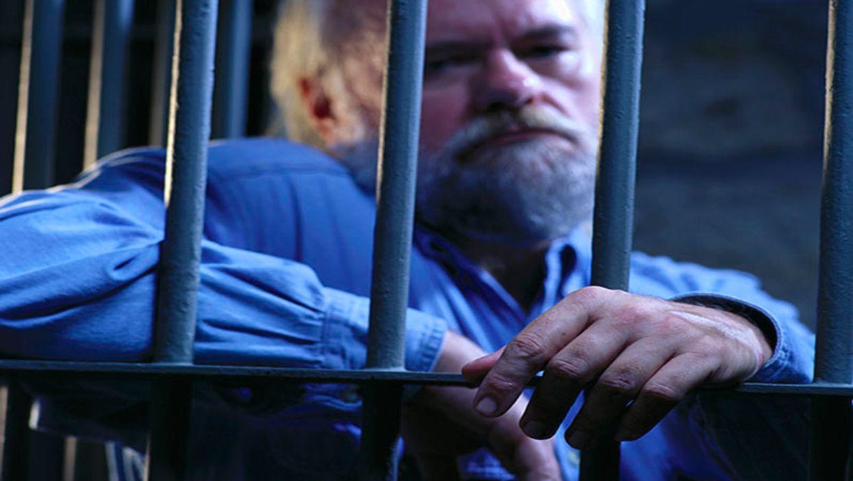 man behind a prison bars