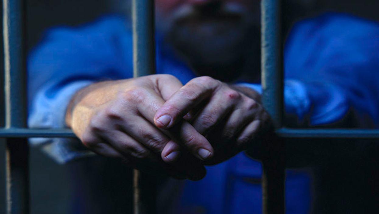 prisoner behind the bars